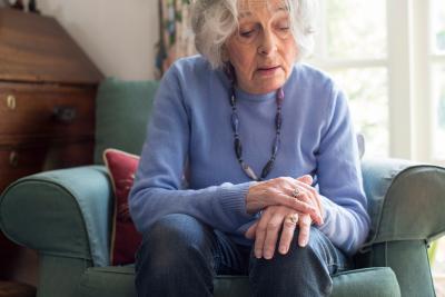elderly woman sitting